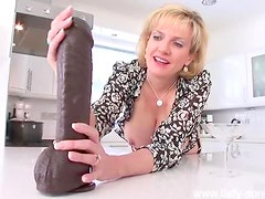 Milf strokes huge black dildo