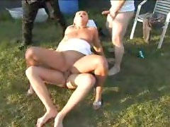 Three guys gangbang a cute blonde outdoors