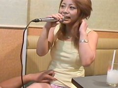 Zesty Japanese cutie bares her small tits in public