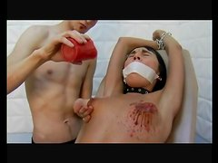 Hot wax drips on her perky little tits for pain