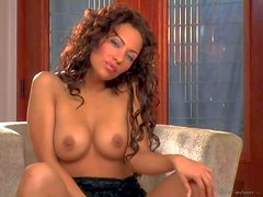 Bridget Banks is one curly haired beautiful adult model with