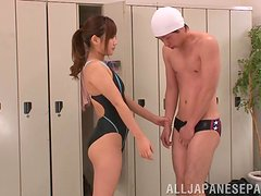 Japanese teen gives a blowjob to some guy in the locker room
