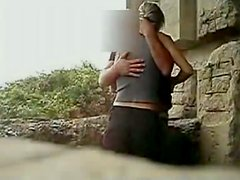 Nasty chick gets banged from behind near the stone wall outdoors