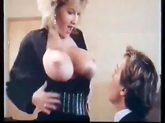 Busty blonde milf gives an ardent blowjob in a hot retro clip