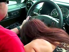 Awesome action with a passionate brunette and her fucker in the car