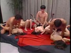 A few Japanese milfs get their vags drilled in a wild orgy