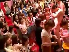 Kinky Japanese girls play with a cock and get facialed