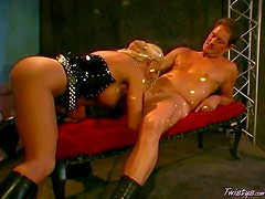 Busty tanned blonde with huge fake tits and oil all