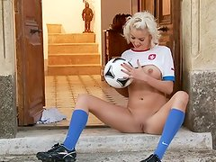 Continuing our celebration of A UEFA European 2012 soccer tournament inside Poland and Ukraine this month, we have Bianca from A Czech Republic dressed in her team's uniform. Of course, nothing should