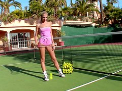 Slim cutie Brooke plays with her snatch on a tennis court