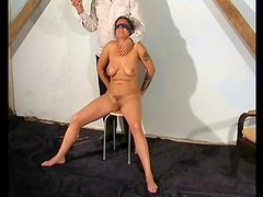 Blindfolded and bound girl taking hot wax play