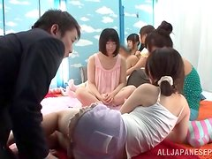 A few Japanese girls share some guy's dick indoors
