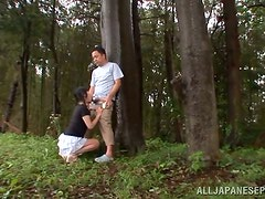 Yuna the sexy Japanese girl gets fucked in a forest