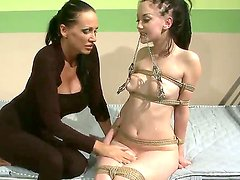 Sadistic mistress Mandy Bright does what she knows best to erase that smirk off of Gina Lorenzzas face