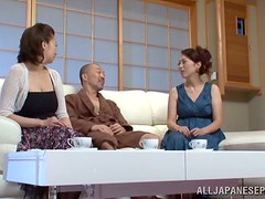Two gorgeous Japanese women get fucked in a threesome