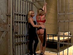 Big breasted prisoner Pamela has her enormous melons groped by the prison guard Kathia Nobili