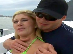 Rich man Josh is fucking with an amazing skinny babe Ava on his big boat, while