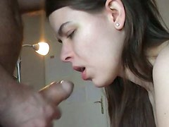Brunette gives a head to horny dick until it cums on her face