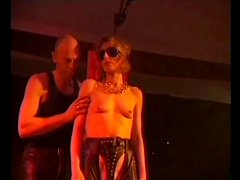 Leather girl bound and flogged in the club