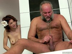Brigitta gets fucked by an old dude in the bathroom