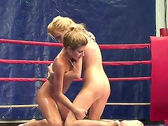 Skinny blondes with beautiful shaved pussies Babette and Ioana fighting on the ring
