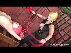 In dungon with lesbian for bondage and hot wax play
