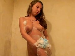 Brown-haired slut Abbey gets sexually aroused while taking a shower