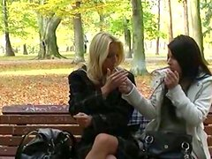 Whorish blonde slut is fingering her snatch in the park in front of the viewers