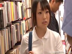 Hot Japanese girl in school uniform has sex in a library