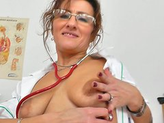 Using a dildo spoiled and ugly nurse Amelie masturbates right in the hospital
