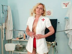 Ugly blond lewd woman Tamara masturbates in the gynecologist's study