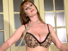 Seductive redhead chick poses on cam having her body hogtied