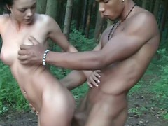 Tremendously hot brunette with nice butt gets fucked from behind in the woods