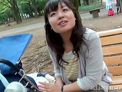 Kinky Japanese milf enjoys playing with a cock in a car