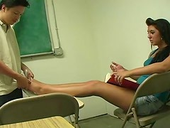 Horny college slut rubs a cock with her feet