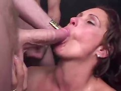 Milf surrounded by cocks sucks