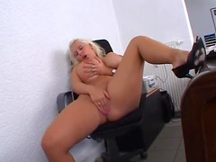 Office babe with giant boobs masturbates