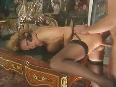 Mature in stockings fucked in her asshole