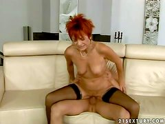 Turned on short haired redhead whore with natural hanging tits