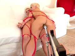 Two stunning blonde girls are getting fucked by sex machine