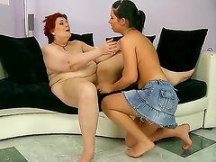 Red haired granny Daisey Lee spread her legs and having her