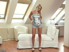 Hot blonde Jessie Jazz strips and plays with her nice pussy