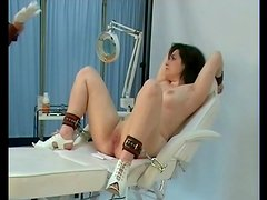 Speculum opens pussy of a bound girl