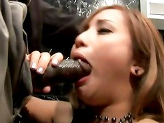 Alluring Tia Tanaka stuffs her mouth with hard cock