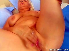 Gorgeous and pretty aroused busty blonde granny enjoys in giving