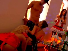 Perverse Russian babe gives a head in front of other folks