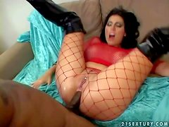 Arousing brunette hooker with big firm hooters and heavy make