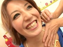 Kawaii smiling Japanese brunette stretches her legs and gets hairy pussy fingered