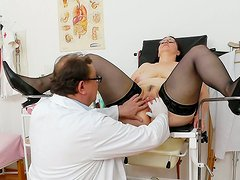 Pallid lewd lady in stockings Dorotha gets her mature twat pleased by doctor