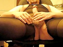 Bear in nylon body suit jerking out a creamy load